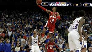 Western Kentucky guard Jamal Crook goes in for a shot during the first half of a second-round game against Kansas in the NCAA men's college basketball tournament Friday, March 22, 2013, in Kansas City, Mo.