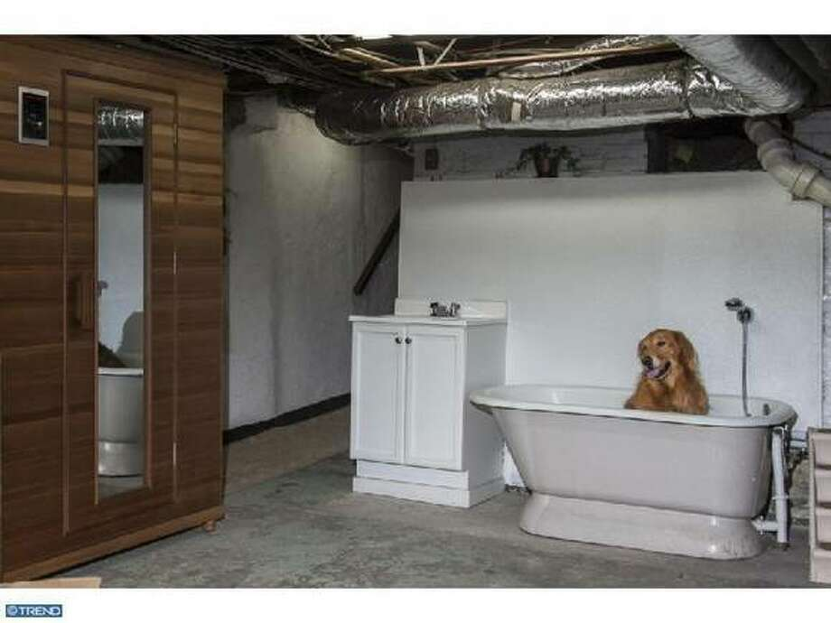 We've seen pets in listing photos before, but the combination of the placement of this pet and the tub in general is quite memorable. Photo via Estately.