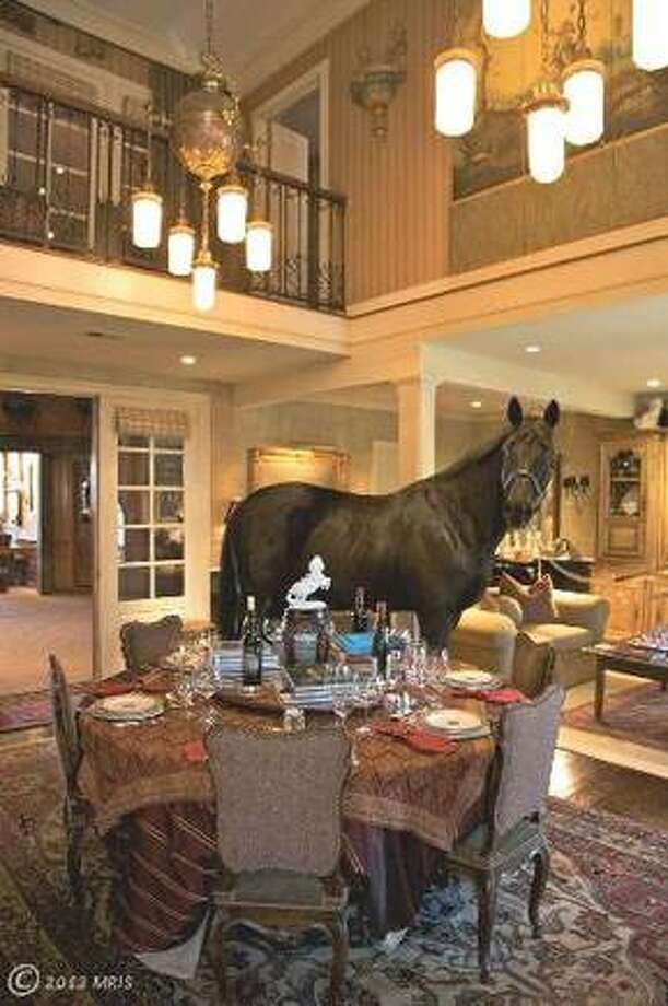A photo for a Virginia horse ranch for sale for $5,999,000. Yet no one thought to take the horses outside before shooting the interior. Photo via Estately.