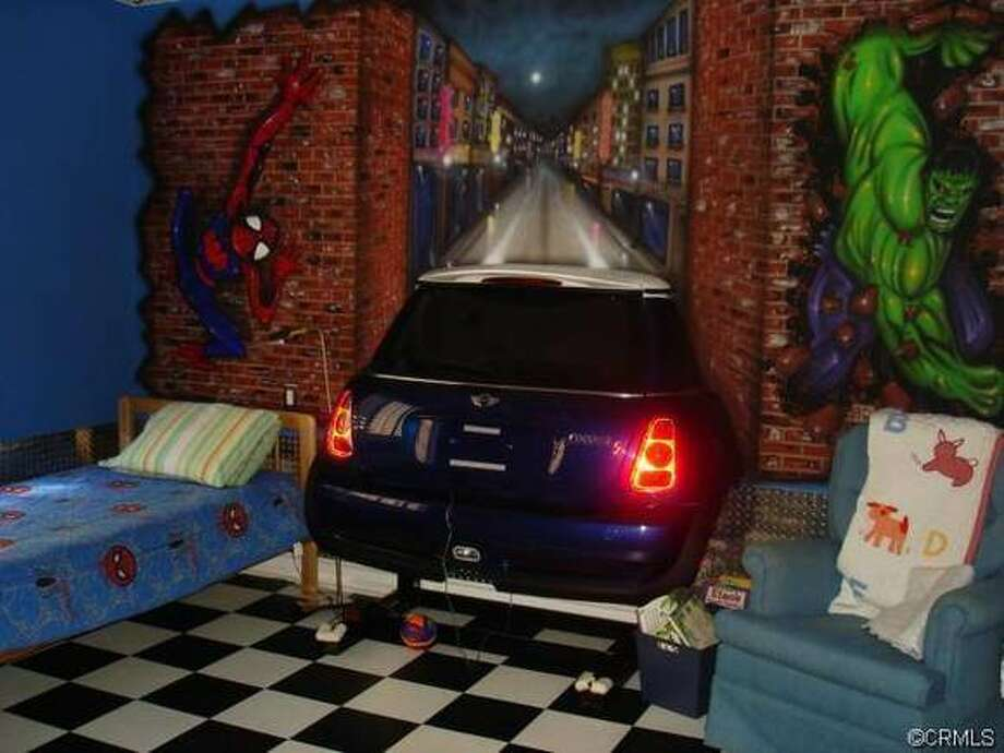 What? Doesn't everyone have this set up at home? Sweet dreams bedroom for your kid and your Mini Cooper.  Photo via WTFRealEstate.com