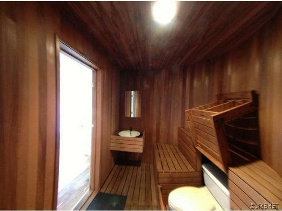 This Studio City home once belonged to comedian Dennis Miller. Was this sauna/bathroom one of his better jokes? Photo via Estately.