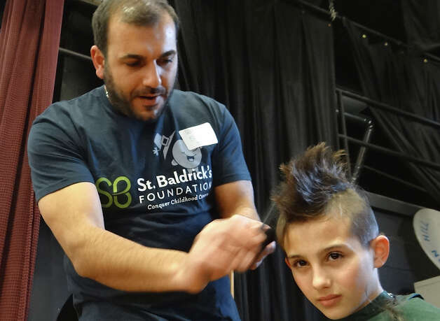 Vinny Ruggiero, 10, gets a hybrid head shaving job from Salon Isa haircutter Mario Guleryuz on Friday at the Team Teddy St. Baldrick's fundraiser at Osborn Hill School.   FAIRFIELD CITIZEN, CT 3/22/13 Photo: Mike Lauterborn / Fairfield Citizen contributed