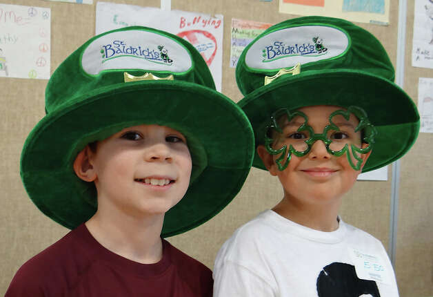 Osborn Hill students Matt Gifford, 10, and Eli Cromwell, 9, dressed their St. Baldrick's best on Friday for the Team Teddy head-shaving fundraiser at Osborn Hill School.   FAIRFIELD CITIZEN, CT 3/22/13 Photo: Mike Lauterborn / Fairfield Citizen contributed