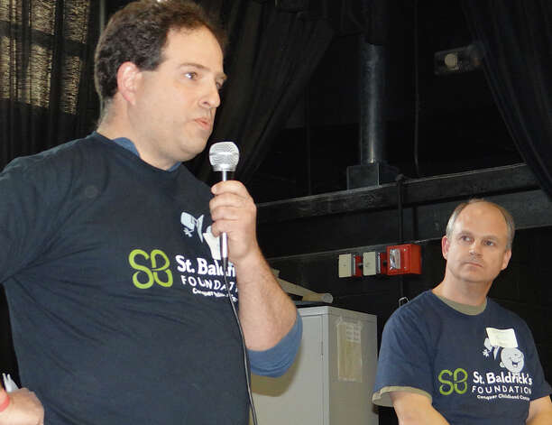 Bill Gerber welcomes the crowd Friday to St. Baldrick's Team Teddy -- named in honor of his late son -- head-shaving fundraiser at Osborn Hill School, as Cub Scout Pack 199 Cubmaster Dave Hinkle looks on.  FAIRFIELD CITIZEN, CT 3/22/13 Photo: Mike Lauterborn / Fairfield Citizen contributed