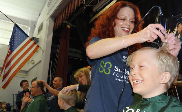 Will Hinkle gets his head shaved Friday by Margie Branca at the St. Baldrick's Team Teddy head-shaving fundraiser at Osborn Hill School.  FAIRFIELD CITIZEN, CT 3/22/13 Photo: Mike Lauterborn / Fairfield Citizen contributed