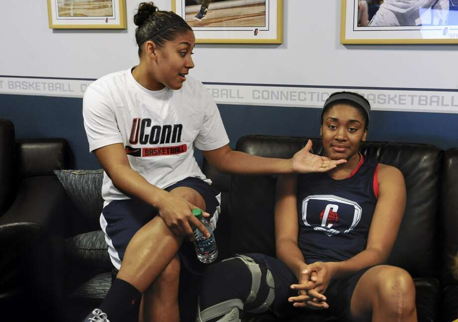 Connecticut's Kaleena Mosqueda-Lewis, left, and Morgan Tuck share a playful moment in their locker room before practice for a first-round game in the women's NCAA college basketball tournament in Storrs, Conn., Friday, March 22, 2013. Connecticut will play Idaho on Saturday. (AP Photo/Jessica Hill)