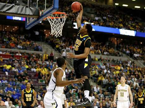 Juvonte Reddic #15 of the Virginia Commonwealth Rams dunks in the first half against Michigan. Photo: Gregory Shamus, Getty Images / 2013 Getty Images