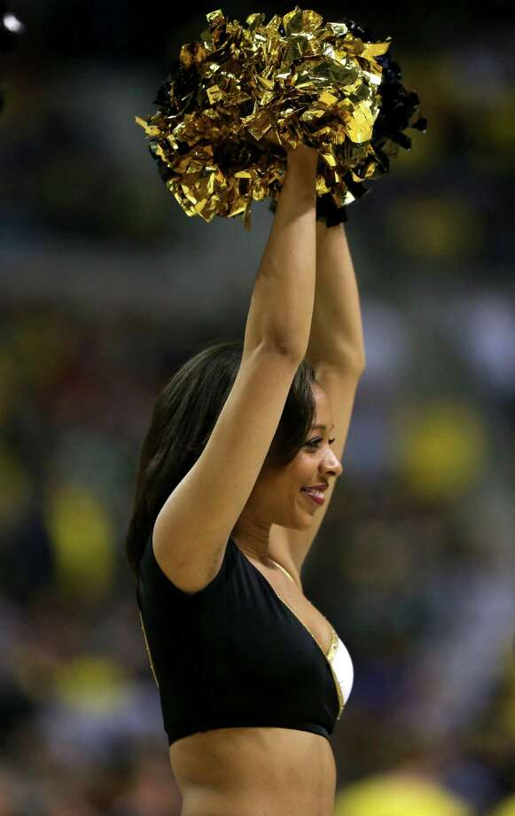 A cheerleader for the Virginia Commonwealth Rams perfroms in the first half against the Michigan Wolverines. Photo: Jonathan Daniel, Getty Images / 2013 Getty Images