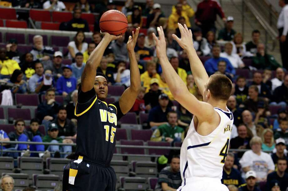 Juvonte Reddic #15 of the Virginia Commonwealth Rams attempts a shot in the first half against Mitch McGary #4 of the Michigan Wolverines. Photo: Gregory Shamus, Getty Images / 2013 Getty Images