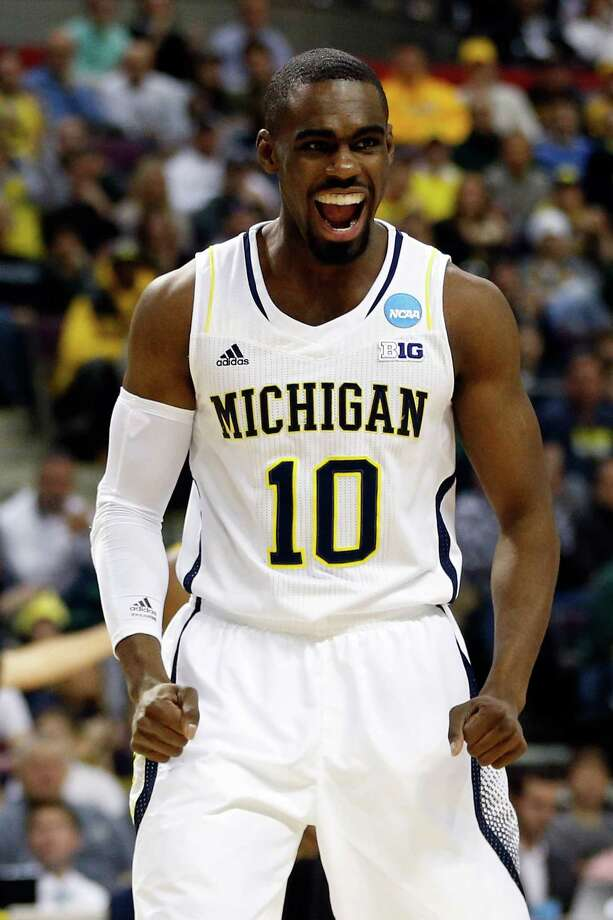 Michigan 78, VCU 53Tim Hardaway Jr. #10 of the Michigan Wolverines reacts in the first half against the Virginia Commonwealth Rams. Photo: Gregory Shamus, Getty Images / 2013 Getty Images