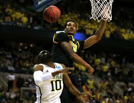 Tim Hardaway Jr. #10 of the Michigan Wolverines is fouled as he went to the basket in the first half against Juvonte Reddic #15 of the Virginia Commonwealth Rams. Photo: Jonathan Daniel, Getty Images / 2013 Getty Images