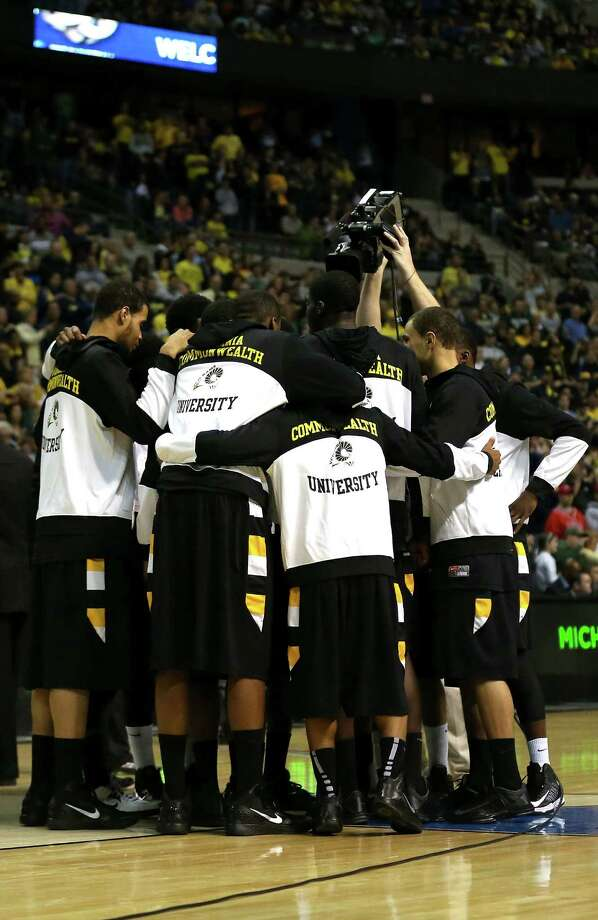 The Virginia Commonwealth Rams huddle up prior to playing against the Michigan Wolverines during the third round. Photo: Jonathan Daniel, Getty Images / 2013 Getty Images