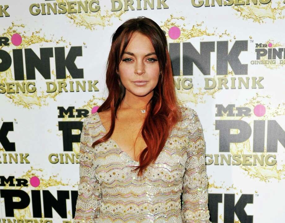 FILE - In this Oct. 11, 2012 file photo, Lindsay Lohan attends the Mr. Pink Ginseng launch party at the Beverly Wilshire hotel in Beverly Hills, Calif. An attorney for Lindsay Lohan says New York City prosecutors will not charge her for an alleged fight at a Manhattan nightclub last November. Attorney Marc Heller says the actress faces no formal charges after prosecutors were unable to gather sufficient evidence to prove the case. Lohan was arrested Nov. 29 on a charge of misdemeanor assault after an incident with Tiffany Mitchell at the club Avenue in the city's trendy Meat Packing district. (Photo by Richard Shotwell/Invision/AP, File) Photo: Richard Shotwell
