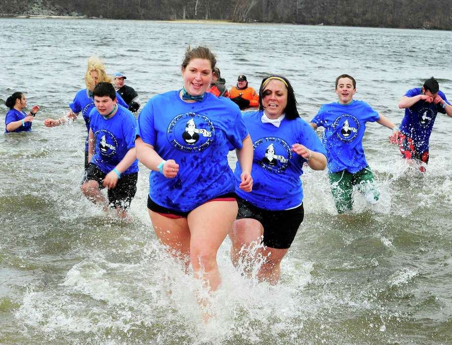 Ability Beyond Disability team members run from the water during the Penguin Plunge into Candlewood Lake at the Danbury Candlewood Park, in Conn. Saturday, March 23, 2013. The event was a fundraiser for local charities including the Connecticut Special Olympics. Photo: Michael Duffy / The News-Times