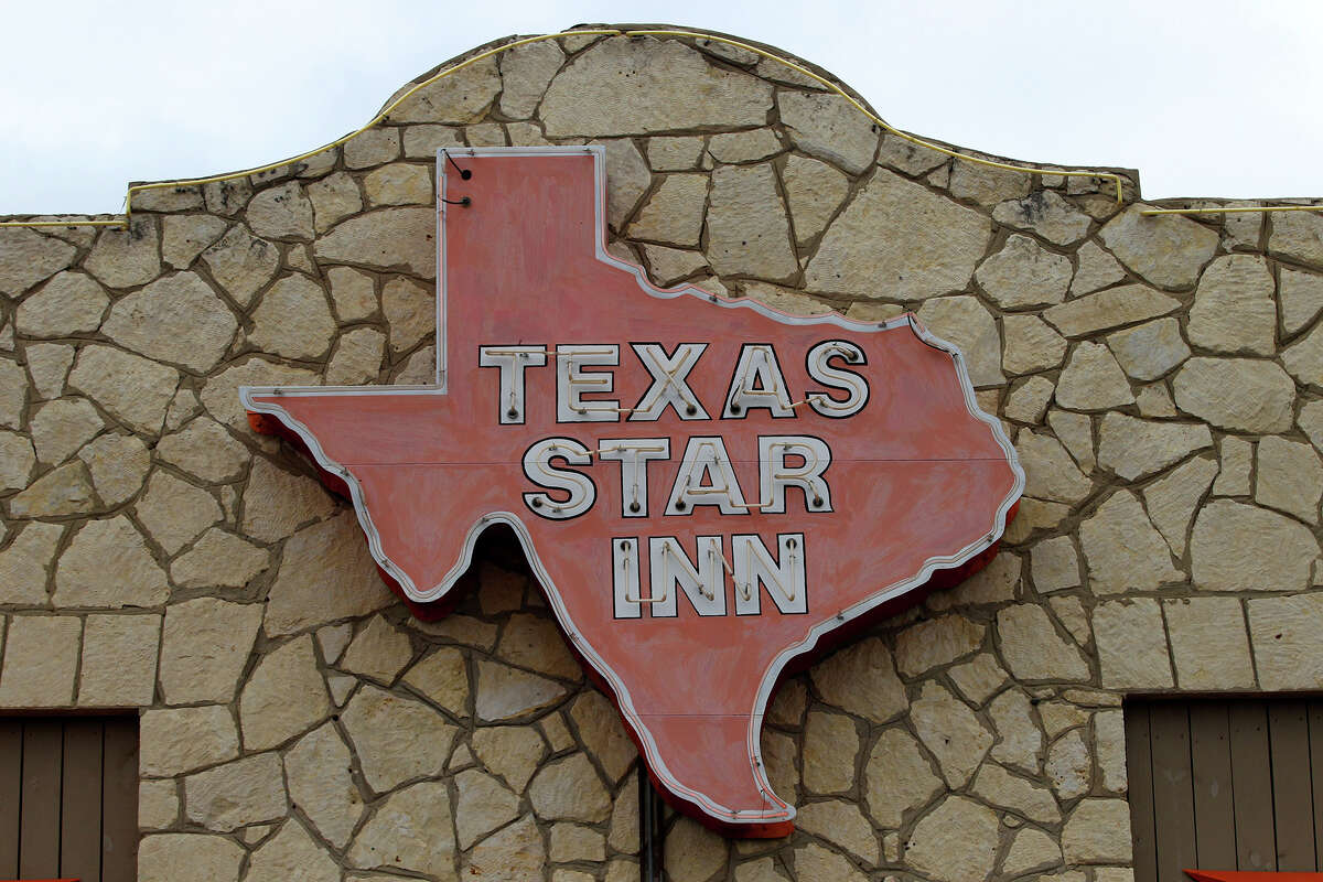 The distinctive sign on the old Texas Star Inn on Bandera Road. It is now a Grady's barbecue restaurant.