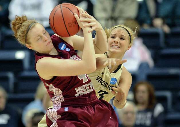 Saint Joseph's Sarah Fairbanks, left, is pressured by Vanderbilt's Heather Bowe, right, during a first-round game in the women's NCAA college basketball tournament in Storrs, Conn., Saturday, March 23, 2013. Photo: Jessica Hill