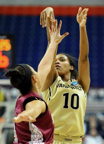 Vanderbilt's Christina Foggie, right, shoots over Saint Joseph's Natasha Cloud, left, during the first half of a first-round game in the women's NCAA college basketball tournament In Storrs, Conn., Saturday, March 23, 2013. Photo: Jessica Hill