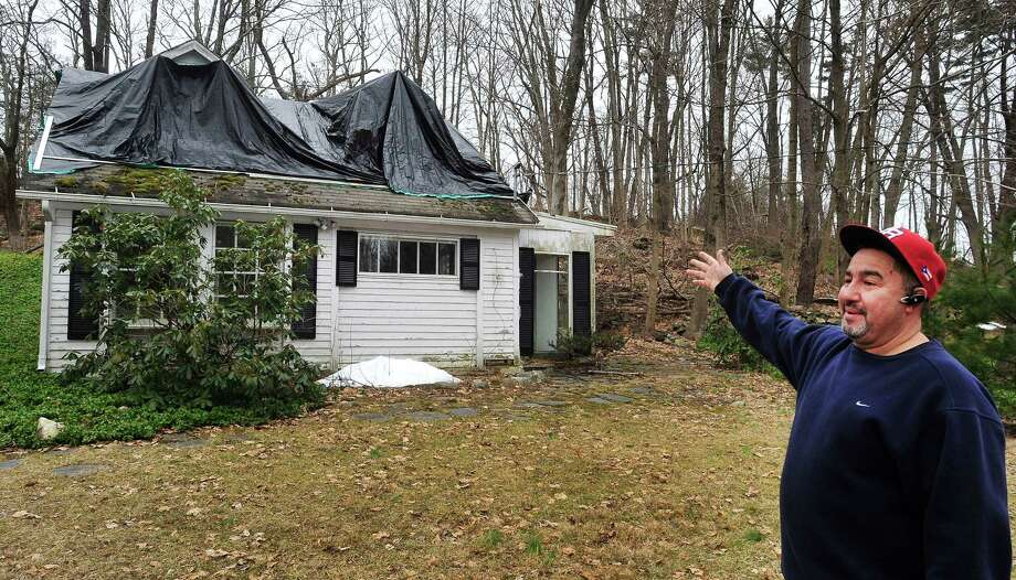 Eli Gonzalez shows the town-owned cottage on the property up for auction in the Brookfield historic zone Saturday, March 16, 2013 in Conn. Gonzalez is a town worker. Photo: Michael Duffy / The News-Times