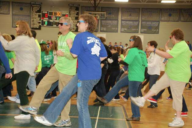 The faculty and staff at Fairfield Ludlowe High School breaks into a flash-mob dance during Friday's Battle of the Houses at the school Friday.  FAIRFIELD CITIZEN, CT 3/22/13 Photo: Jarret Liotta / Fairfield Citizen contributed