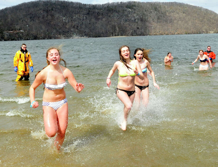This is the Penguin Plunge into Candlewood Lake at the Danbury Candlewood Park, in Conn. Saturday, March 23, 2013. The event was a fundraiser for local charities including the Connecticut Special Olympics. Photo: Michael Duffy / The News-Times