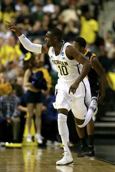 AUBURN HILLS, MI - MARCH 23:  Tim Hardaway Jr. #10 of the Michigan Wolverines reacts in the second half against the Virginia Commonwealth Rams during the third round of the 2013 NCAA Men's Basketball Tournament at The Palace of Auburn Hills on March 23, 2013 in Auburn Hills, Michigan. Photo: Jonathan Daniel, Getty Images / 2013 Getty Images