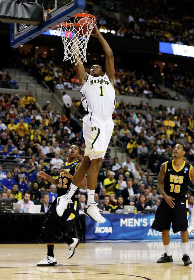 Glenn Robinson III #1 of the Michigan Wolverines dunks in the second half against the Virginia Commonwealth Rams. Photo: Gregory Shamus, Getty Images / 2013 Getty Images