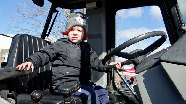 William Hall, 2, of Fairfield, behind the wheel of a Gault Energy backhoe at Touch-A-Truck sponsored Saturday by the Westport Weston Cooperative Nursery.   WESTPORT NEWS, CT 3/23/13 Photo: Mike Lauterborn / Westport News contributed
