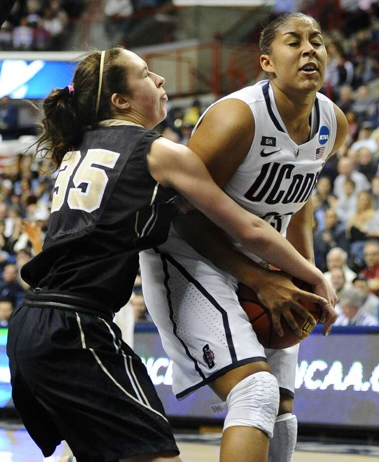 Connecticut's Kaleena Mosqueda-Lewis, right, is pressured by Idaho's Connie Ballestero, left, in the first half of a first-round game in the women's NCAA college basketball tournament in Storrs, Conn., Saturday, March 23, 2013. (AP Photo/Jessica Hill)