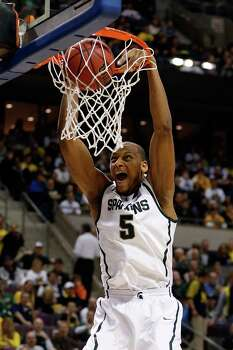 Michigan State 70, Memphis 48Adreian Payne #5 of the Michigan State Spartans dunks in the first half against the Memphis Tigers during the third round. Photo: Gregory Shamus, Getty Images / 2013 Getty Images