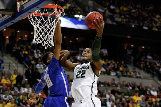 Branden Dawson #22 of the Michigan State Spartans drives for a shot attempt in the first half against D.J. Stephens #30 of the Memphis Tigers. Photo: Gregory Shamus, Getty Images / 2013 Getty Images