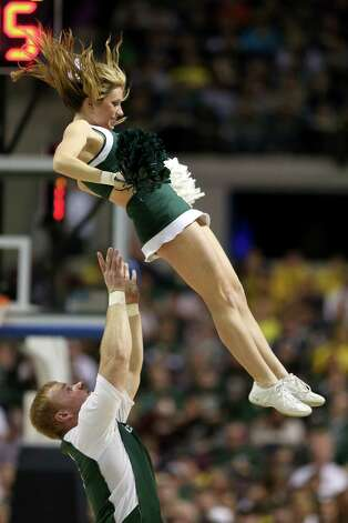 Cheerleaders for the Michigan State Spartans perform against the Memphis Tigers. Photo: Jonathan Daniel, Getty Images / 2013 Getty Images