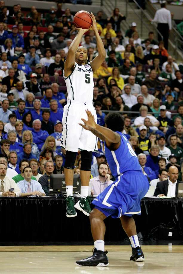 Adreian Payne #5 of the Michigan State Spartans attempts a shot against the Memphis Tigers. Photo: Gregory Shamus, Getty Images / 2013 Getty Images
