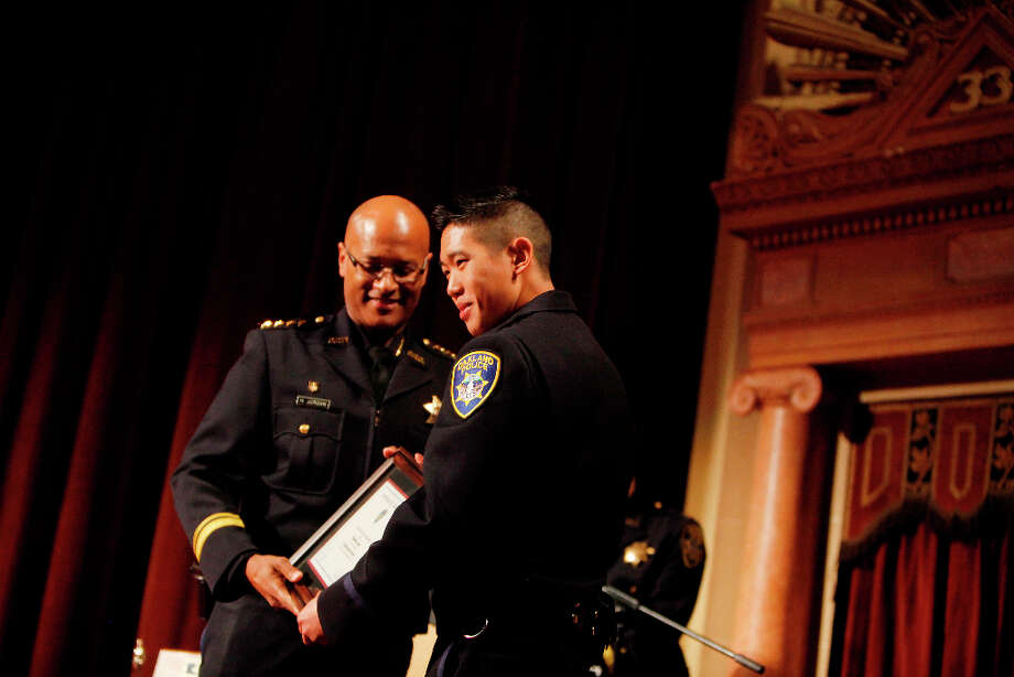 Oakland Police Chief Howard Jordan gives Brent Lowe his Valedictorian Award during the Oakland Police Department's 166th Basic Academy Graduation Exercise at the Scottish Rite Center on Friday, March 22, 2013 in Oakland, Calif. Photo: Lea Suzuki, The Chronicle / ONLINE_YES