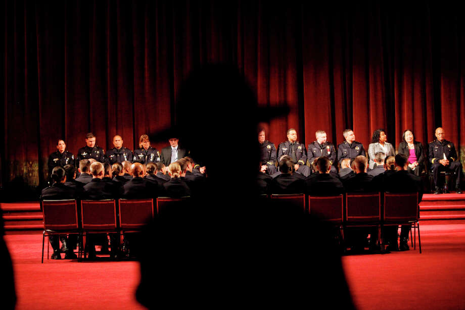 The Oakland Police Department's 166th Basic Academy sits in their chairs facing the stage during Graduation Exercise at the Scottish Rite Center on Friday, March 22, 2013 in Oakland, Calif. Photo: Lea Suzuki, The Chronicle / ONLINE_YES
