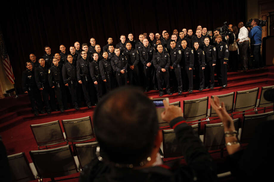 Friends, family and colleagues take a group portrait of the Oakland Police Department's 166th Basic Academy graduating class during Graduation Exercise at the Scottish Rite Center on Friday, March 22, 2013 in Oakland, Calif. Photo: Lea Suzuki, The Chronicle / ONLINE_YES