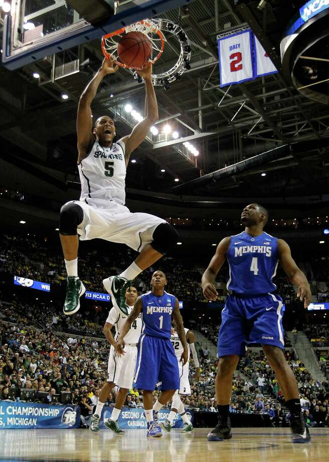 Adreian Payne #5 of the Michigan State Spartans dunks in the first half against Adonis Thomas #4 of the Memphis Tigers. Photo: Gregory Shamus, Getty Images / 2013 Getty Images
