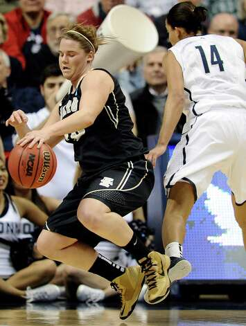 Idaho's Stacey Barr, left, is fouled by Connecticut's Bria Hartley, right, in the first half of a first-round game in the women's NCAA college basketball tournament in Storrs, Conn., Saturday, March 23, 2013.  Connecticut won 105-37. (AP Photo/Jessica Hill) Photo: Jessica Hill, Associated Press / FR125654 AP