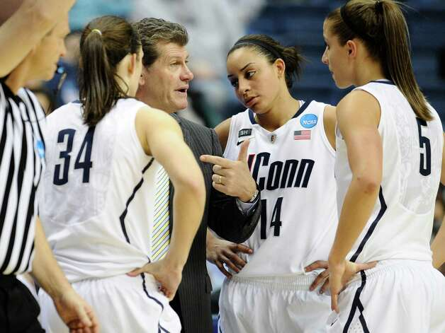 Connecticut head coach Geno Auriemma, second from left speaks with players Kelly Faris, left, Bria Hartley, second from right, and Caroline Doty, right, during the second half of a first-round game against Idaho in the women's NCAA college basketball tournament in Storrs, Conn., Saturday, March 23, 2013. Connecticut won 105-37. (AP Photo/Jessica Hill) Photo: Jessica Hill, Associated Press / FR125654 AP