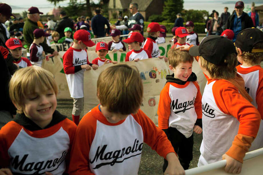 Boys from a host of Magnolia baseball teams goof around while waiting for the parade to begin. Photo: JORDAN STEAD / SEATTLEPI.COM