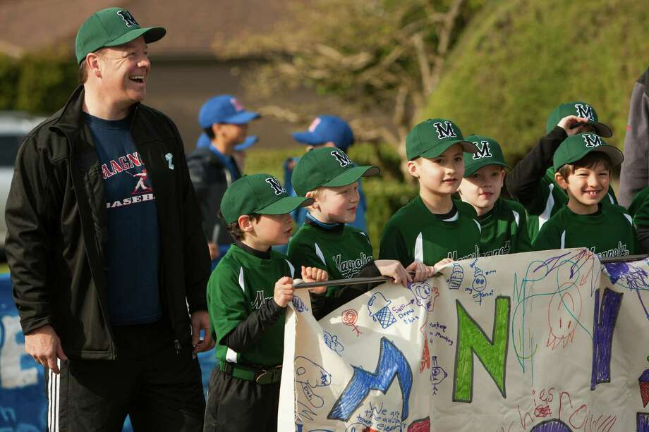 Hundreds of children from a host of Magnolia baseball teams enjoyed a sunny march down West McGraw Street. Photo: JORDAN STEAD / SEATTLEPI.COM