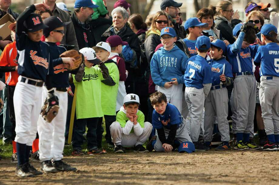 Hundreds of children from a host of baseball teams relax at Magnolia Playfield following the parade. Photo: JORDAN STEAD / SEATTLEPI.COM