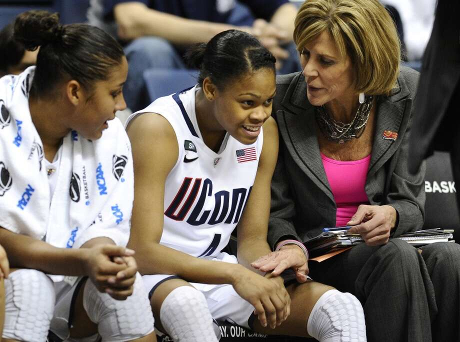 Connecticut's Moriah Jefferson, center, smiles as associate head coach Chris Dailey, right, speaks to her, and teammate Kaleena Mosqueda-Lewis, left, sits near in the second half of a first-round game in the women's NCAA college basketball tournament against Idaho in Storrs, Conn., Saturday, March 23, 2013. Jefferson scored 16 points as Connecticut won 105-37. (AP Photo/Jessica Hill)