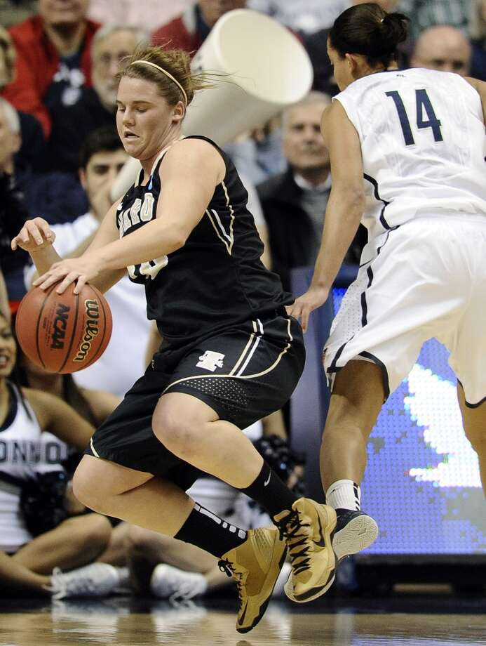 Idaho's Stacey Barr, left, is fouled by Connecticut's Bria Hartley, right, in the first half of a first-round game in the women's NCAA college basketball tournament in Storrs, Conn., Saturday, March 23, 2013.  Connecticut won 105-37. (AP Photo/Jessica Hill)