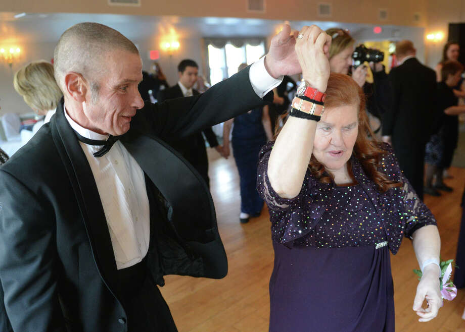 Bob Weir and Grace Betrone dance at the Ability Beyond Disability prom at Capellaro's Grove in Bethel, Conn. on Friday, March 22, 2013.  Danbury High School seniors Paige Rotunda, Victoria Moran and Kimberly Rios organized the prom for members of Bethel Ability Beyond Disability for a project in their peer leadership class.  More than 80 people attended the event. Photo: Tyler Sizemore / The News-Times