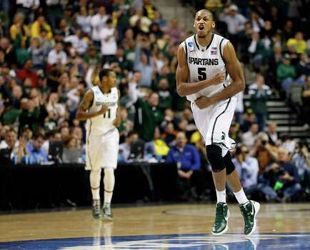 Adreian Payne #5 of the Michigan State Spartans celebrates in the second half against the Memphis Tigers. Photo: Gregory Shamus, Getty Images / 2013 Getty Images