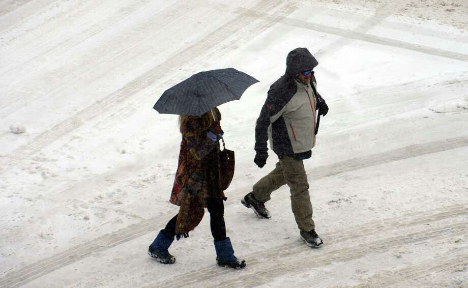 Pedestrians walk across 14th Street in the snow in Boulder, Colo. on Saturday, March 23, 2013. (AP Photo/The Daily Camera, Cliff Grassmick) NO SALES Photo: Cliff Grassmick, Associated Press / Daily Camera