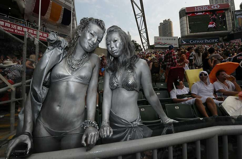 Wearing a bikiniwon't always get you noticed at the Hong Kong Rugby Sevens tournament. Spray-painting yourself silver wearing a bikini might though. Photo: Antony Dickson, AFP/Getty Images