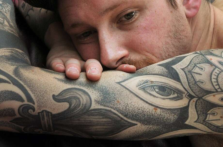 Impressive needlework:A man with a well-inked arm gets a new tat from an artist at the Tattoo World Fair in Paris. Photo: Pierre Andrieu, AFP/Getty Images