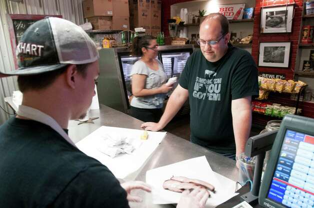 Daniel Vaughn, right, a barbecue aficionado, places an order at Lockhart Smokehouse in Dallas, March 21, 2013. Vaughn has been hired by Texas Monthly as its first barbecue editor, a position that exists at no other magazine in America. (Rex C. Curry/The New York Times) Photo: REX C. CURRY, NYT / NYTNS
