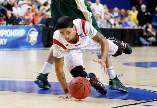 LEXINGTON, KY - MARCH 23:  Peyton Siva #3 of the Louisville Cardinals falls trying to dribble around Colton Iverson #45 of the Colorado State Rams in the first half during the third round of the 2013 NCAA Men's Basketball Tournament at Rupp Arena on March 23, 2013 in Lexington, Kentucky. Photo: Kevin C. Cox, Getty Images / 2013 Getty Images